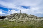 picture of cross hill  - Perran cross stunning hill near perranporth with blue clouds and fluffy clouds