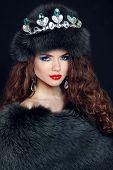 Beauty Fashion Model Girl In Fur Coat. Diamond Jewelry. Beautiful Luxury Winter Woman In Fur Hat.