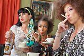 Three Women Drinking And Smoking