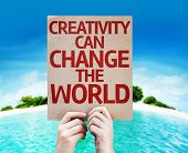 Creativity Can Change The World card with a beach on background