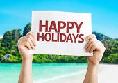 Happy Holidays card with a beach on background