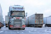 Fleet Of Scania Trailer Trucks On Wintry Icy Yard