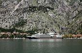 KOTOR, MONTENEGRO - JUNE, 08: Cruiser docked in the port of Kotor, on June 08, 2012, in Kotor, Montenegro