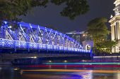 picture of singapore night  - scenic night illumination of famous Anderson bridge in Singapore downtown - JPG