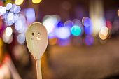 Wooden spoon and light bulbs