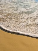 Sand and wave on the beach