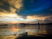 Little girl at Sunset on the beach of Ao Nang in Krabi Thailand
