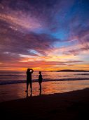 Couple at Sunset on the beach of Ao Nang in Krabi Thailand