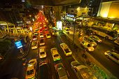 BANGKOK, THAILAND - DEC 18, 2014: Traffic jam in city centre at night. Bangkok's traffic problem getting worse, since government in 2012 y. introduced a policy to refund tax for first-time car buyers.