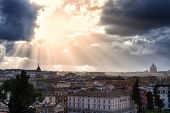 Cityscape Of Rome Under A Dramatic Sky