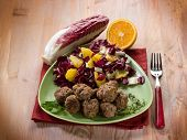 meatball with red chicory and orange salad