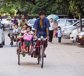 Schoolchildren On Cyclos In Yangon