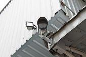 Cctv Security Camera At The Wall