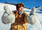 Girl snowboarder in a good mood