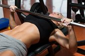 Young Woman On Bench Press