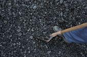 stock photo of power-shovel  - Miner man working at shoveling coal mine - JPG