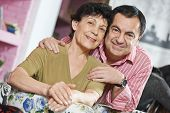 Happy smiling adult senior couple. Man embracing a woman