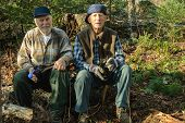foto of hunter  - Elderly seniors hunters resting and taking a drink after working in the woods of Quebec Canada - JPG