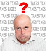 Frustrated businessman in tax time.