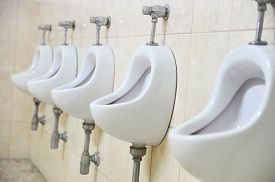 picture of urinate  - Detail with five white urinals in a public men - JPG
