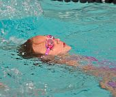 Young Girl Backstroke In Pool