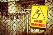 stock photo of transformer  - Danger high voltage warning sign on a fence in transformer station - JPG