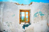stock photo of abandoned house  - Old window in abandoned house with beautiful view at sea - JPG
