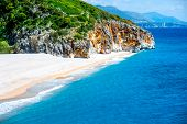 picture of albania  - Gjipe beach with rocks and river in Albania - JPG