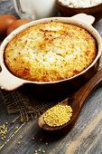 picture of millet  - Casserole with millet and curd on the wooden table - JPG