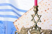 picture of matzah  - Menorah and matzah in front of a blue and white tallit - JPG