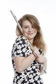 pic of flute  - teenage girl in dress holds flute in studio against white background - JPG