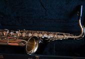 stock photo of saxophones  - Vintage yellow saxophone is in the bag - JPG