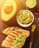 picture of nachos  - Green Guacamole with nachos and avocado on stone background - JPG