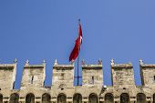 pic of harem  - battlements of the ancient walls of Topkapi Palace and the Turkish flag - JPG