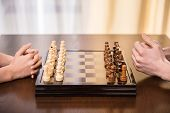 image of chessboard  - Two people are playing chess - JPG