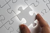 picture of jigsaw  - Holding jigsaw piece Jigsaw and puzzles concepts - JPG