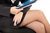 pic of fingers crossed  - portrait of woman in business clothing with documents - JPG