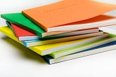 fan-shaped stack of coloured books