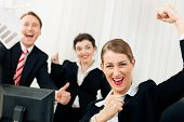Businesspeople in office having great success