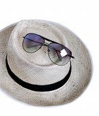 Straw Hat And Sun Glasses