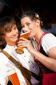 Couple in Bavarian Tracht drinking wheat beer
