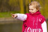 Little girl ashore of river