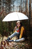 Brunette Girl Under Light Umbrella