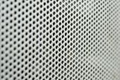 metal grill with circular holes and short depth of field poster