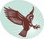 woodcut owl swooping