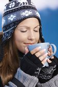 Nice Girl Drinking Hot Tea In Winter Eyes Closed