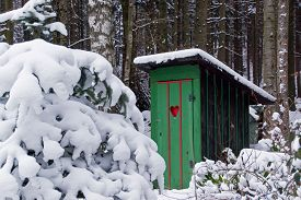stock photo of outhouse  - Rural old outhouse in winter - JPG