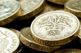 foto of scottish thistle  - Macro studio shot of different British pound Coins including Queen Elizabeth - JPG