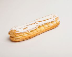stock photo of eclairs  - An eclair with white chocolate on white background  - JPG