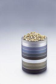 image of seed bearing  - Hemp seeds on metallic rings pedestal in a grey gradient background - JPG